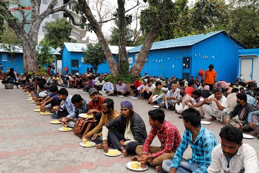 Representative Image. Daily wage workers and homeless people eat food inside a government-run night shelter during a 21-day nationwide lockdown to limit the spreading of coronavirus disease (COVID-19), in the old quarters of  Delhi, India, March 26, 2020. REUTERS/Anushree Fadnavis