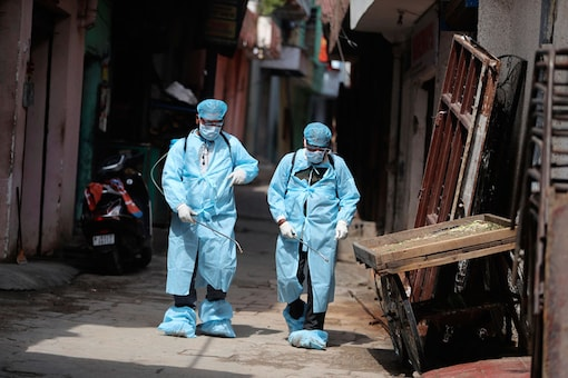 For representation: Health workers spray disinfectants as a precautionary measure against COVID-19 in a residential area in Jammu. (Image: AP)