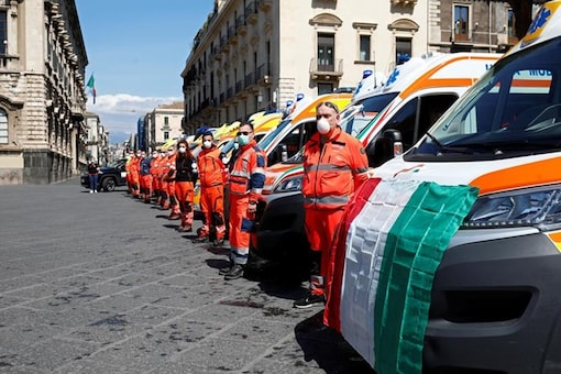Emergency services in Catania join a ceremony to mark a minute's silence around Italy on Tuesday. (Reuters)