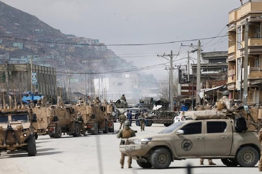 Afghan security forces inspect near the site of an attack in Kabul, Afghanistan. (Reuters)