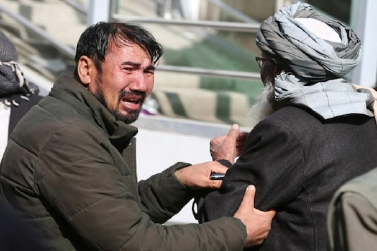 Afghan men cry at a hospital after they heard that their relative was killed during an attack in Kabul, Afghanistan. (Reuters)