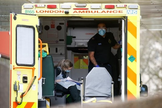 Medical staff in a Ambulance outside a hospital as the spread of the coronavirus disease (COVID-19) continues, London, Britain. (Reuters)