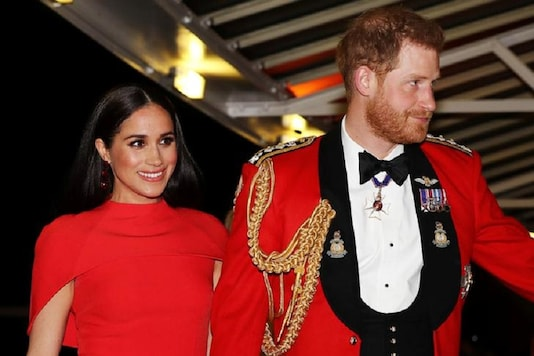 Prince Harry and his wife Meghan, arrive at the Mountbatten Festival of Music at the Royal Albert Hall in London. (Reuters)