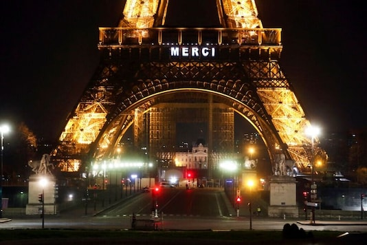 """The word """"Merci"""", the French word for 'Thank you"""", is emblazoned on the Eiffel Tower as France's coronavirus death toll continued to climb, in Paris, Friday, March 27, 2020. (AP Photo/Thibault Camus)"""