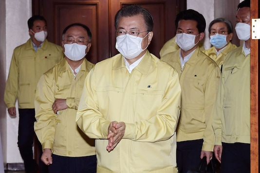 South Korean President Moon Jae-in, wearing a face mask arrives to preside over a cabinet meeting at a government complex in downtown Seoul, South Korea. (Image: AP)