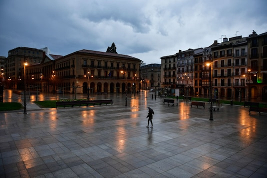 A person walks through an empty Plaza del Castillo square in the old city, in Pamplona, northern Spain. (Image: AP)