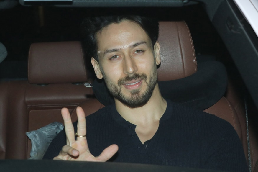 Tiger Shroff waves to the photographers on his arrival at the special screening of Baaghi 3 in Mumbai. (Image: Viral Bhayani)