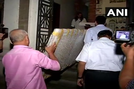 The painting was taken to the ED headquarters on Monday evening. (ANI/Twitter)