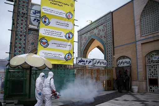 Members of the medical team spray disinfectant to sanitize outdoor place of Imam Reza's holy shrine, following the coronavirus outbreak, in Mashhad, Iran. (Reuters)