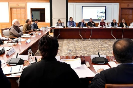 File photo of PM Narendra Modi and officials meeting for COVID-19 tackling measures.