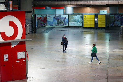 Commuters walk at an almost empty Atocha train station at rush hour during partial lockdown as part of a 15-day state of emergency to combat the coronavirus outbreak in Madrid, Spain. (Reuters)