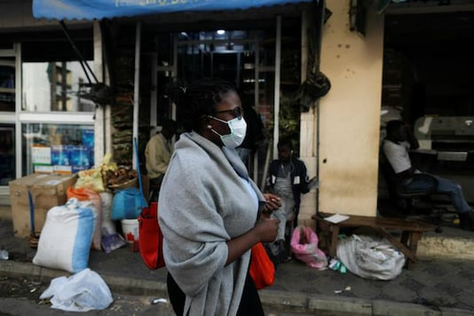 In this representational image, a woman wears a mask to protect herself from the novel coronavirus. (Reuters)