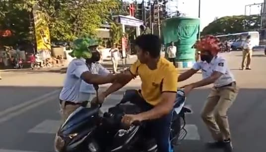 Screengrab of the video showing Bengaluru cops' act of Coronavirus attack.