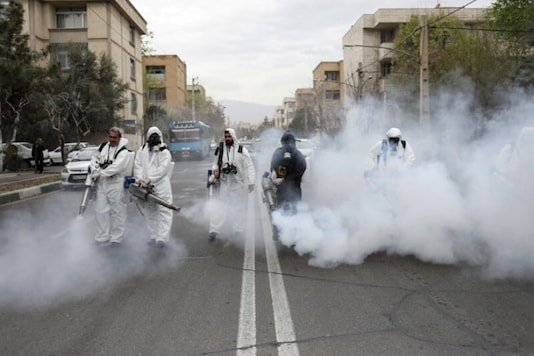 File photo of firefighters disinfecting streets in Tehran (Reuters)