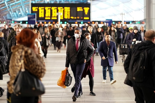 A man is seen wearing a protective face mask at Waterloo station in London, Britain. (REUTERS)