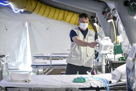 A staffer checks equipment in the ICU room at the Samaritan's Purse field hospital that is being set up in Cremona, northern Italy on March 20, 2020. (Claudio Furlan/LaPresse via AP)