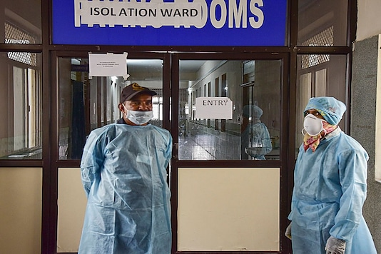 Representative Image. Healthcare workers stand outside an isolated ward for coronavirus patients. (Photo: PTI)