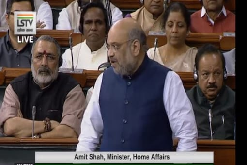 Union Home Minister Amit Shah makes a statement on the Delhi riots in Lok Sabha on Wednesday. (Photo: Twitter/ANI)