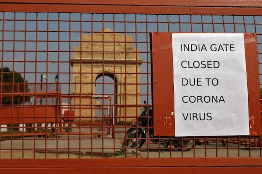 A sign pasted on a security barricade at the India Gate war memorial in New Delhi. (Reuters)