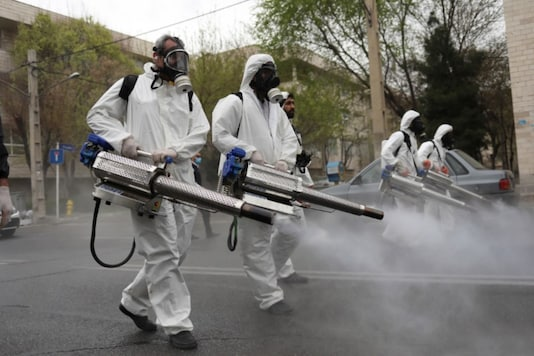 Members of firefighters disinfect the streets in Tehran. (Reuters)