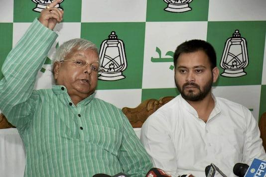 File photo of RJD chief Lalu Prasad Yadav with son and Tejashwi Yadav. (PTI)