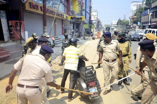 Police personnel beat a scooterist with batons as they enforce complete lockdown for containing the spread of the novel coronavirus. (PTI)