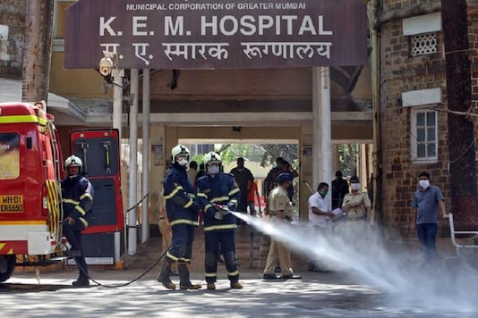 Firefighters disinfect the exteriors of a government-run hospital to limit the spreading of coronavirus disease (COVID-19), in Mumbai, India. REUTERS/Prashant Waydande