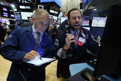 Traders work on the floor of the New York Stock Exchange on March 9, 2020. (AP Photo/Richard Drew)