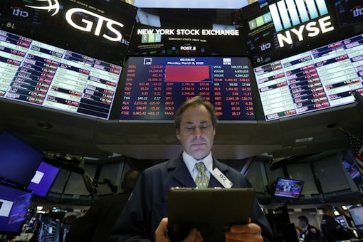 File photo of a trader works on the floor of the New York Stock Exchange. (AP Photo/Richard Drew)