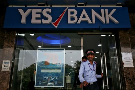 A watchman steps out of a Yes Bank branch in Mumbai. (Reuters)