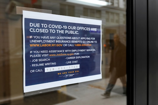 FILE PHOTO: Signage is seen posted on the entrance of the New York State Department of Labor offices, which closed to the public due to the coronavirus disease (COVID-19) outbreak in the Brooklyn borough of New York City, U.S., March 20, 2020. REUTERS/Andrew Kelly/File Photo