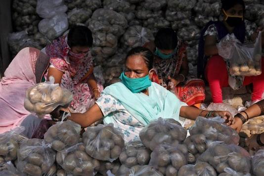 Volunteers pack potatoes to be distributed to needy during coronavirus lockdown. (Reuters)