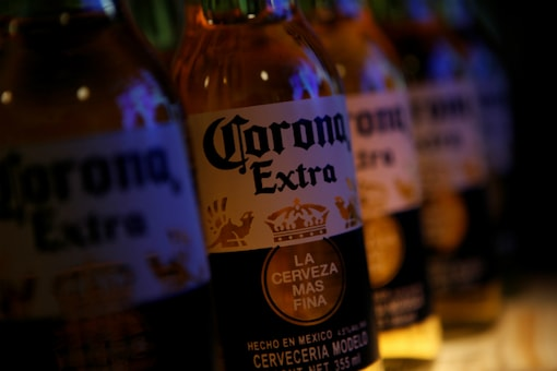 Bottles of Corona beer, the flagship brand of Group Modelo, are pictured at a restaurant in Mexico City, Mexico on January 27, 2017. (REUTERS/Henry Romero/Files)