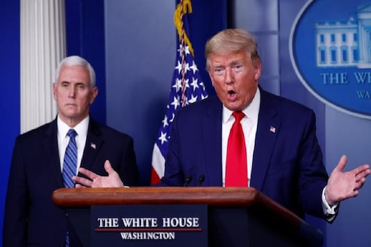 US President Donald Trump addresses the daily coronavirus task force briefing as Vice President Mike Pence listens at the White House in Washington, US. (Reuters)
