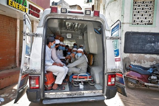 For representation: Men, who according to health and police officials had visited three Muslim missionary gatherings including in Nizamuddin area of New Delhi, wearing protective masks sit in an ambulance that will take them to a quarantine facility amid concerns about the spread of coronavirus disease (COVID-19), in Ahmedabad, India, April 3, 2020. REUTERS/Amit Dave