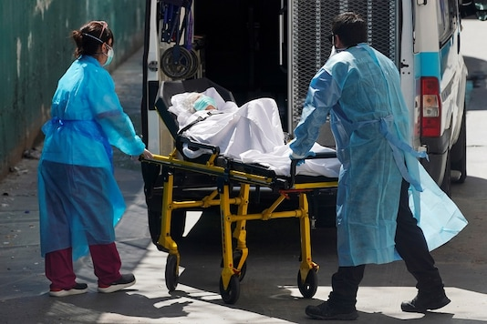 Ambulance workers push a stretcher with a patient at a nursing home during the coronavirus disease (COVID-19) outbreak in Leganes Madrid, near Madrid, Spain, April 2, 2020. REUTERS/Juan Medina