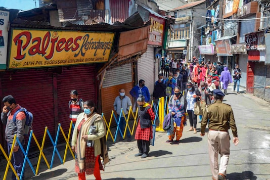 File photo: People maintaining safe distance stand in queue to buy vegetables during the ongoing nationwide lockdown, in Shimla on April 4, 2020. (PTI Photo)
