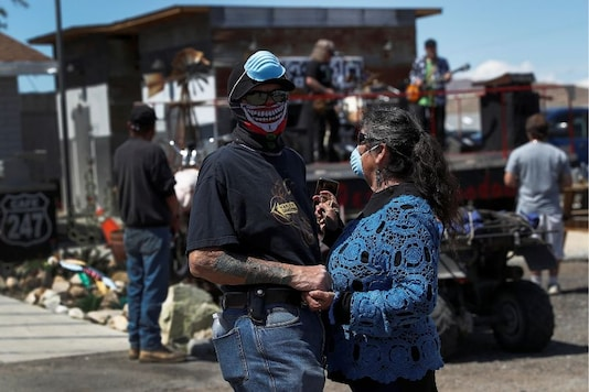 For representation: People wearing face masks hold hands as a band plays amid an outbreak of the coronavirus disease (COVID-19), at Cafe 247 in Lucerne Valley, California, U.S., April 5, 2020. (REUTERS/Shannon Stapleton)