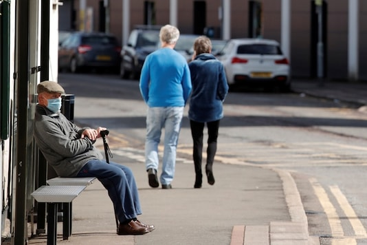 A man wearing a protective face waits for a bus in Watford, as the spread of the coronavirus disease (COVID-19) continues, Watford, Britain, April 6, 2020. (Image: REUTERS)