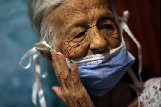 Maria Araque, 90, wears a protective mask at her house during the nationwide quarantine due to the coronavirus disease (COVID-19) outbreak in Caracas, Venezuela March 25, 2020. (Reuters/Manaure Quintero)