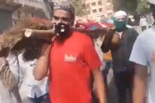 Video grab of Muslim men taking part in the funeral procession of an elderly Hindu women in Indore.
