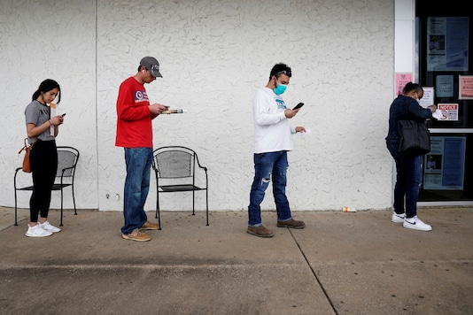 For representation: People who lost their jobs wait in line to file for unemployment following an outbreak of the coronavirus disease (COVID-19), at an Arkansas Workforce Center in Fayetteville, Arkansas, US. (Reuters)