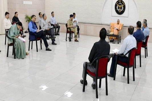 UP Chief Minister Yogi Adityanath holds a meeting with officials to review the preparedness and take stock of the situation in the view of coronavirus outbreak, at his residence in Lucknow. (PTI)