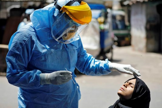 A doctor readies to take a swab to test for coronavirus. (Reuters)