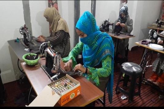 Women at sewing masks in Anantnag.