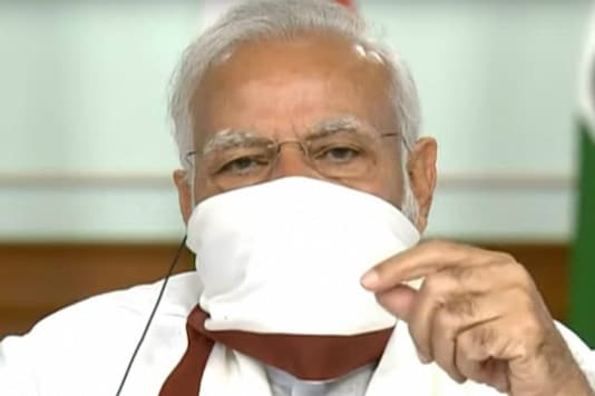 Prime Minister Narendra Modi wears a protective mask while chairing a virtual meeting with chief ministers on Covid-19 response.