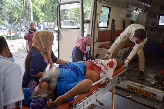A Nihang injured during a clash with Punjab police being taken to a hospital for treatment, during the nationwide lockdown to curb the spread of coronavirus in Patiala on Sunday. (PTI)