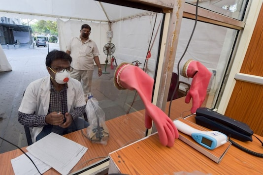 New Delhi: A doctor attends a patient who has come for a check-up at Flu Corner in Charak Palika Hospital during the nationwide lockdown to curb the spread of coronavirus, at Moti Bagh, in New Delhi, Sunday, April 12, 2020. NDMC has designed and constructed 24x7 Flu Corner. (PTI)