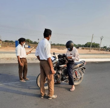 RSS Sevaks guarding police check post and scanning commuters in Telangana. (Twitter)