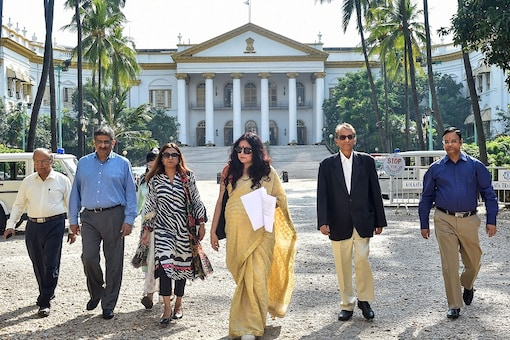 Fashion designer-turned-BJP leader Agnimitra Paul (C) with other members leave the Governor House in Kolkata. (PTI Photo)